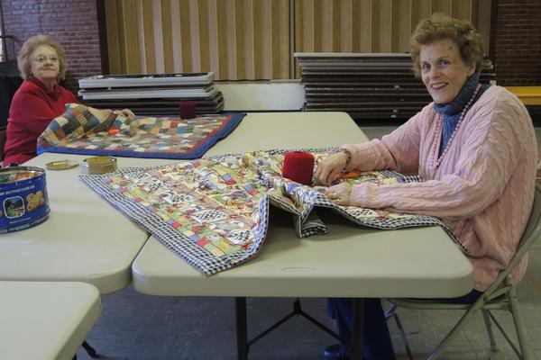 Janet and Jean tieing quilts.